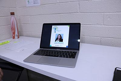 a laptop screen displays a business card