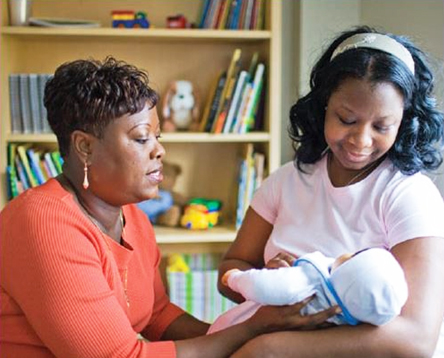 Grandmother and mother caring for baby