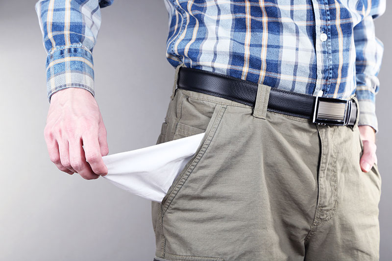 Man pulls out empty pocket from his pants