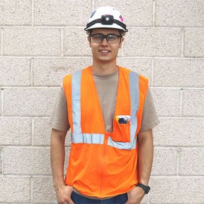 Young man wearing construction clothing.