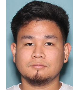 An Asian male with brown hair, brown eyes, a goatee, and pierced ears.