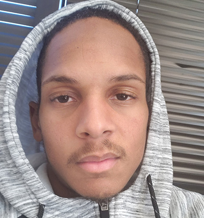 a young Black man wearing a hoodie