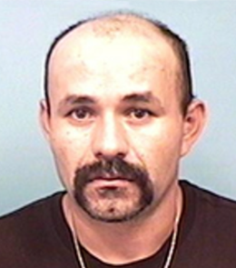 A Hispanic male with black eyes, black hair, mustache and goatee.