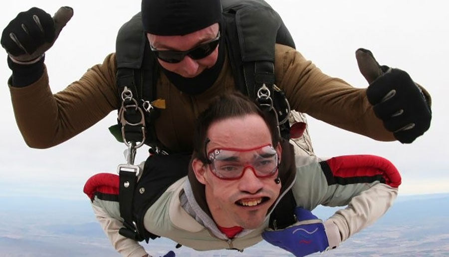 Two men are tandem skydiving