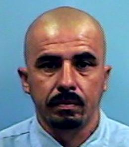 A Hispanic male with brown eyes, shaved head, mustache and goatee