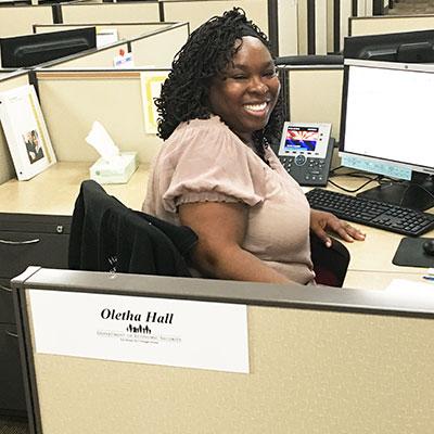 Woman (Oletha Hall) sitting at a desk
