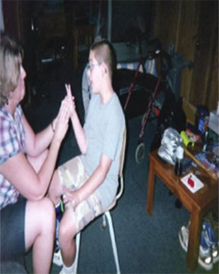 Young man learning American Sign Language