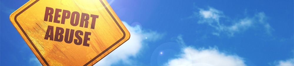Traffic sign with Stop Abuse written on it with a bright blue sky in the background
