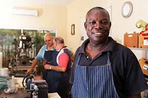 Adult black male smiling at workshop