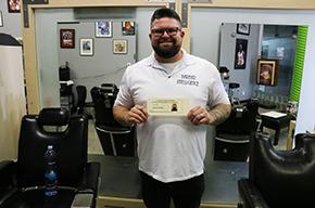 Apprenticeship man presenting certificate
