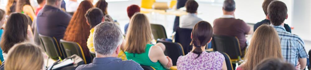Group of People in Meeting Listening to Speaker
