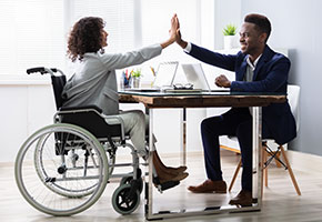Disabled Businesswoman Giving High Five To His Partner