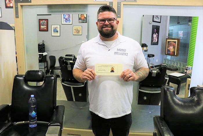 a man holding a certificate