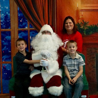 a family poses for a photo with Santa Claus