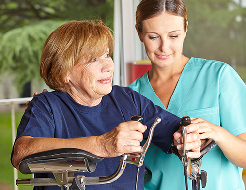 Nurse providing habilitative support to a patient at home.