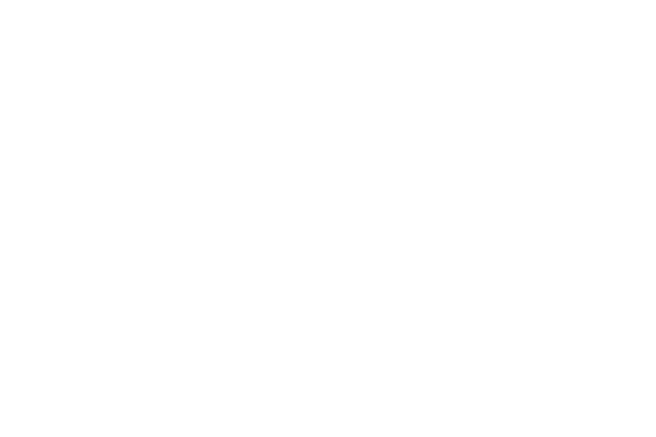 the silhouettes of two office buildings with a businessman standing nearby