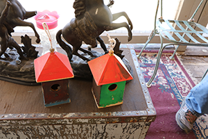 Two colorful, homemade wooden birdhouses.