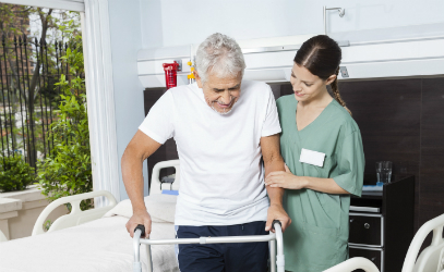 Nurse assisting a patient with a walker