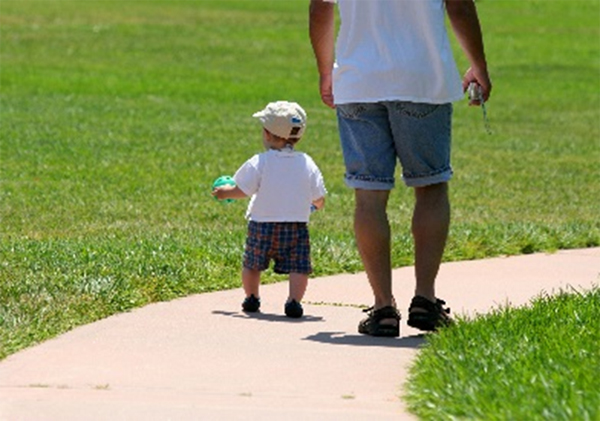 Toddler walking at the park