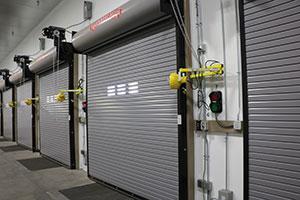 Several garage doors shut in trucking area