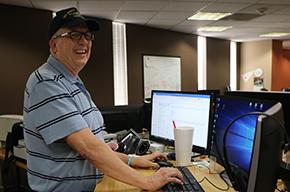 veteran male typing on laptop