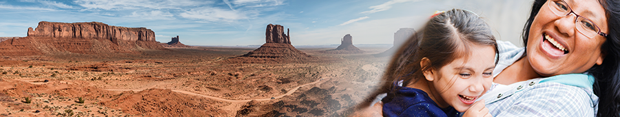 mother and daughter; red mountain in a desert landscape
