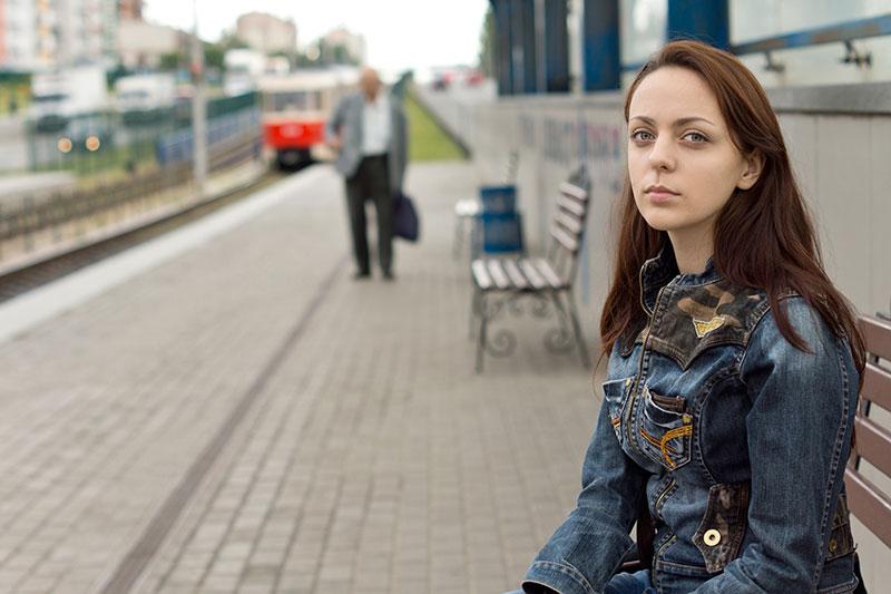 sad woman sitting on bench