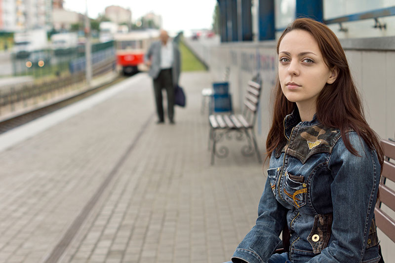 sad woman sitting on bench
