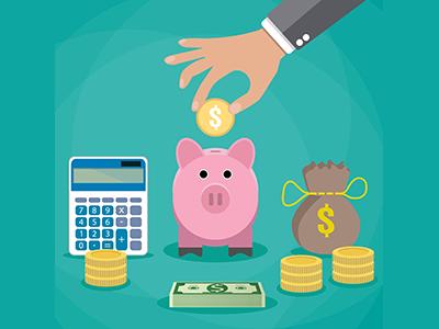 a person's hand placing a coin into a piggy bank