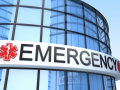 """a sign on a building reads """"EMERGENCY"""""""