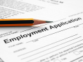 a pencil laying on top of an employment application