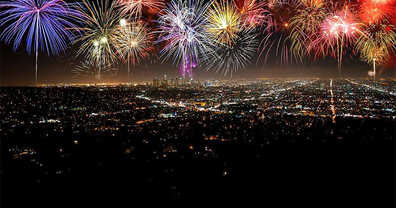 colorful fireworks bursting above a city's night sky