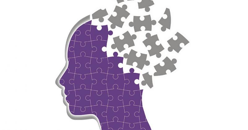 Graphic of a person's profile, composed of puzzle pieces
