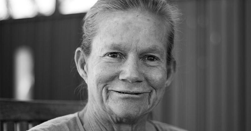 an older woman smiling at the camera