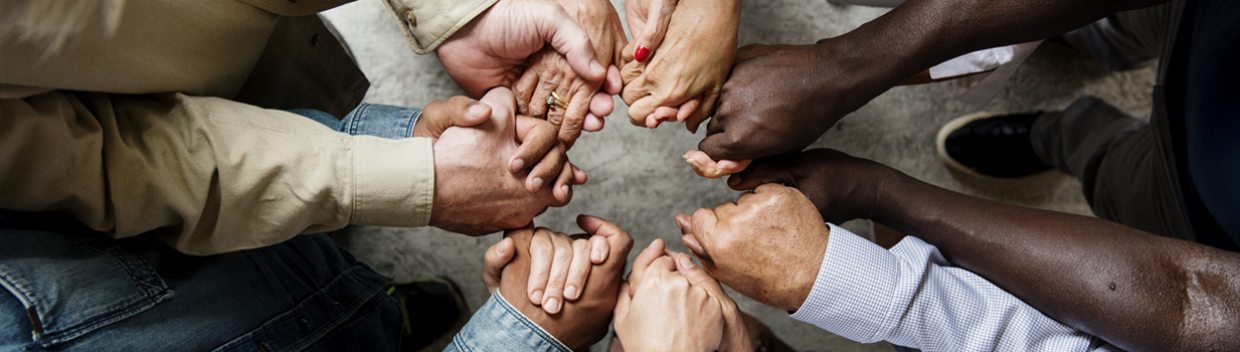 people's hands linked together in a circle