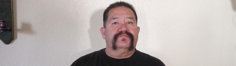 a man wearing a black t-shirt