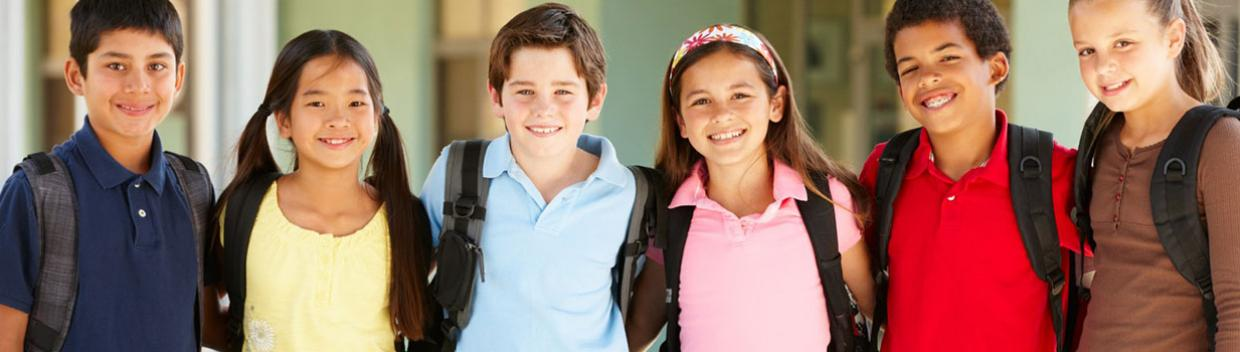 a diverse group of boys and girl wearing backpacks