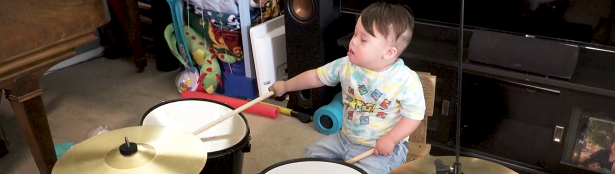 a little boy playing the drums