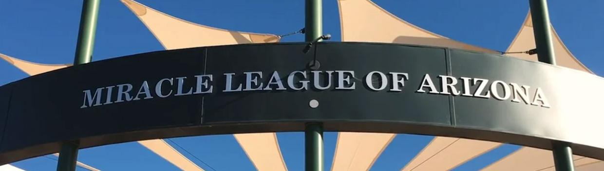 "a sign that read ""Miracle League of Arizona"""