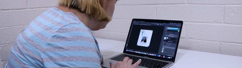 a woman using a laptop computer