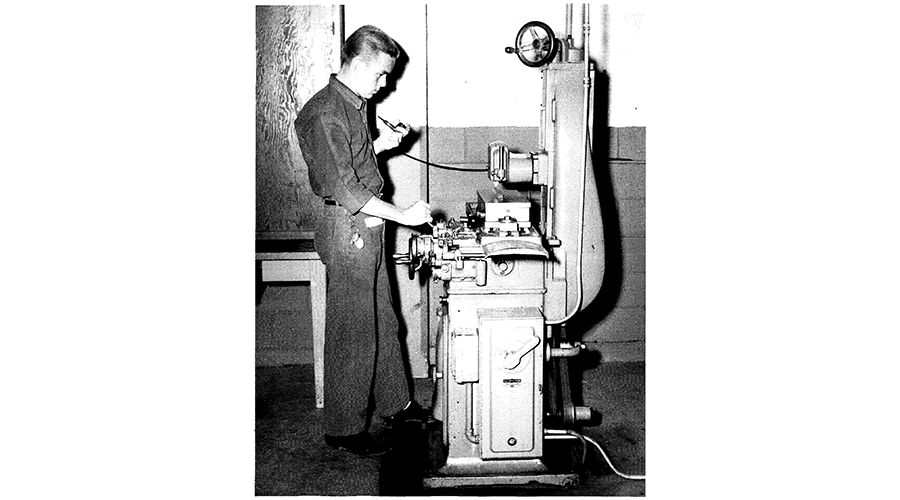 man working with a large machine