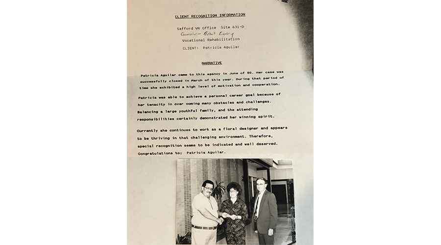 old document with photo of two businessmen and a businesswoman