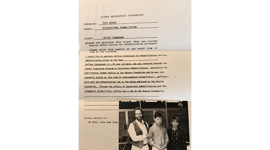 an old document with a photo of a young man standing between a man and woman