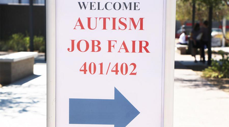 A sign reading Welcome Autism Job Fair