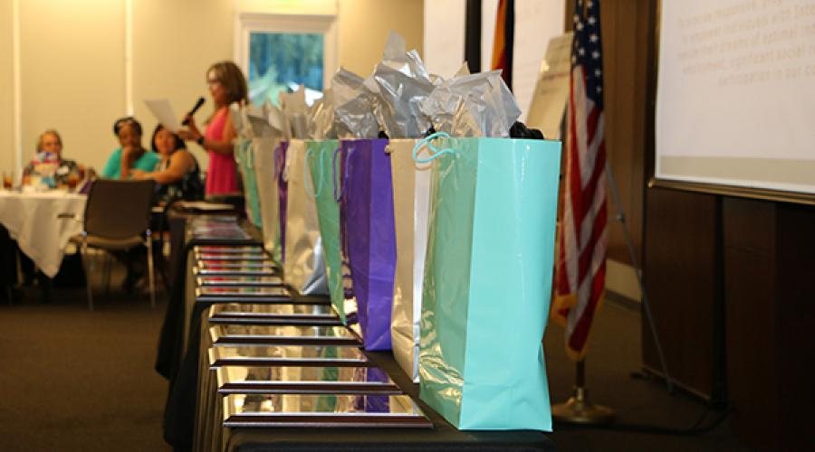 Gift bags and awards line a table
