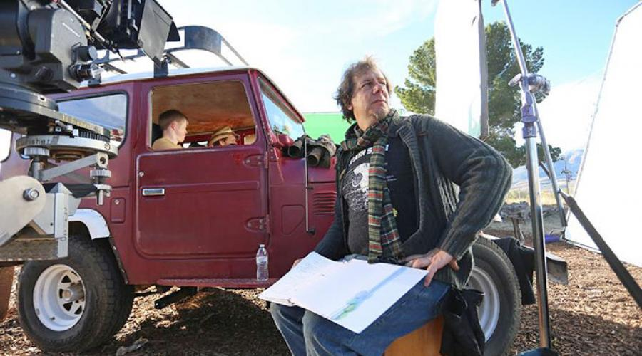 a man sits in a movie set
