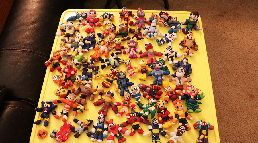 various colorful clay figures displayed on a tray