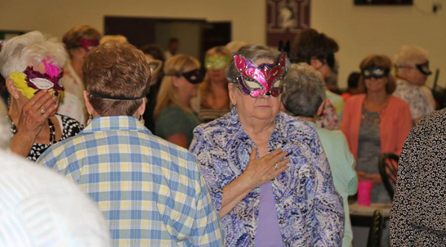 people wearing masquerade masks