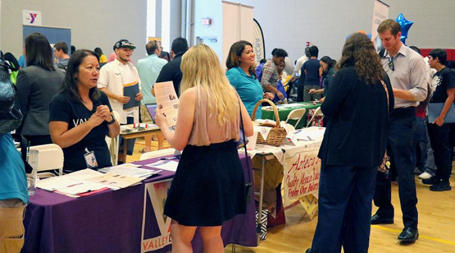 job seekers talk to employers at job fair