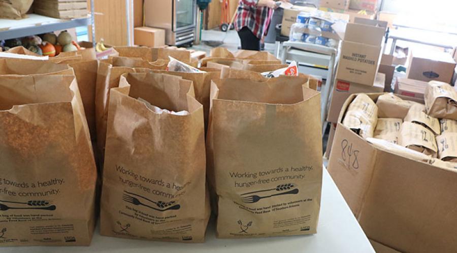 paper bags full of food